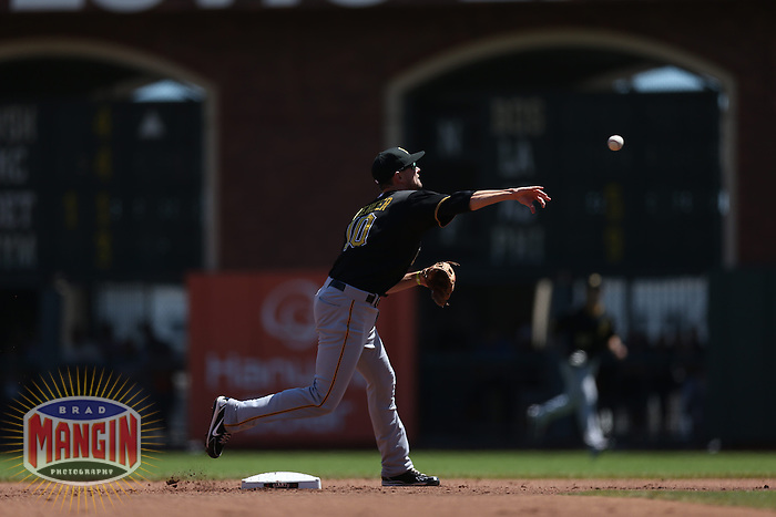 SAN FRANCISCO, CA - AUGUST 25:  Jordy Mercer #10 of the Pittsburgh Pirates makes a play at second base during the game against the San Francisco Giants at AT&T Park on Sunday, August 25, 2013 in San Francisco, California. Photo by Brad Mangin