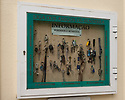 A community lost and found display cabinet full of lost keys, Sesimbra, Portugal.