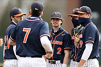 CHAPEL HILL, NC - FEBRUARY 27: Max Cotier #2 of Virginia huddles with his teammates before taking the field for the bottom of the first inning during a game between Virginia and North Carolina at Boshamer Stadium on February 27, 2021 in Chapel Hill, North Carolina.