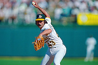 OAKLAND, CA - Dennis Eckersley of the Oakland Athletics pitches during Game 3 of the American League Championship Series against the Toronto Blue Jays at the Oakland Coliseum in Oakland, California in 1992. Photo by Brad Mangin