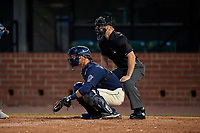 Mobile BayBears catcher Jack Kruger (10) and umpire Mark Stewart during a Southern League game against the Jacksonville Jumbo Shrimp on May 7, 2019 at Hank Aaron Stadium in Mobile, Alabama.  Mobile defeated Jacksonville 2-0.  (Mike Janes/Four Seam Images)