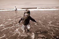summer at the beach. a small girl. Oceanside Oregon United States Oregon Coast.