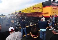 Feb. 19, 2012; Chandler, AZ, USA; NHRA funny car driver Jeff Arend warms up his car in the pits during the Arizona Nationals at Firebird International Raceway. Mandatory Credit: Mark J. Rebilas-