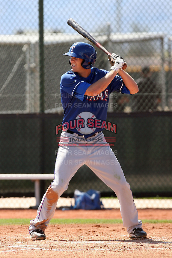 Jared Hoying of the Texas Rangers plays in a minor league spring training game against the Kansas City Royals at the Rangers minor league complex, on March 22, 2011  in Surprise, Arizona. .Photo by:  Bill Mitchell/Four Seam Images.