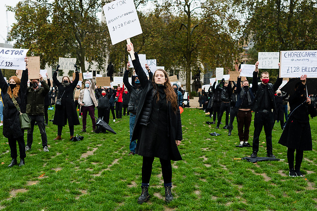 """Theatre Performers, Creatives and Technicians members from the events industry gather during the #WeMakeEvents - """"Survival in the Square"""" protest at Parliament Square on October 28, 2020 in London, United Kingdom. The aim is to showcase the breadth of live events and the technical supply chain that support them, and that live events need government policies in place to help people to return to work and further financial aid until everyone can return. The protest has been organised by We Stand As One #WeMakeEvents who are calling for meaningful support from the Government until the industry is allowed to operate for an industry that provides over 600,000 jobs in UK. Photo: AMMP/Maciek Musialek"""