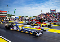 May 4, 2018; Commerce, GA, USA; NHRA top fuel driver Antron Brown (near) races alongside teammate Leah Pritchett during qualifying for the Southern Nationals at Atlanta Dragway. Mandatory Credit: Mark J. Rebilas-USA TODAY Sports