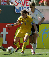 Malin Mostroem, left, Kerstin Garefrekes, right, Germany 2-1 over Sweden at the  WWC 2003 Championships.