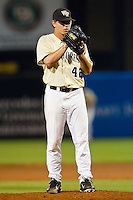 Wake Forest Demon Deacons relief pitcher Nate Jones #42 looks to his catcher for the sign against the Miami Hurricanes at NewBridge Bank Park on May 25, 2012 in Winston-Salem, North Carolina.  The Hurricanes defeated the Demon Deacons 6-3.  (Brian Westerholt/Four Seam Images)