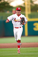 Greg Garcia (7) of the Springfield Cardinals runs back to the dugout during a game against the Arkansas Travelers at Hammons Field on June 13, 2012 in Springfield, Missouri. (David Welker/Four Seam Images)