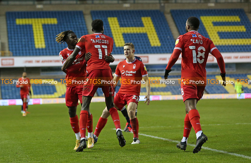 first goal scored for Nottingham Forest by Alex Mighten of Nottingham Forest as he and his teammates celebrate during Millwall vs Nottingham Forest, Sky Bet EFL Championship Football at The Den on 19th December 2020