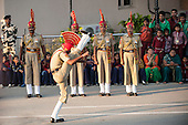 Amritsar, Punjab, India. Indian soldier high kick march during the ceremony of closing the gates at the India Parkistan border.