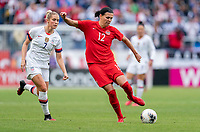 CARSON, CA - FEBRUARY 9: Christine Sinclair #12 of Canada passes the ball during a game between Canada and USWNT at Dignity Health Sports Park on February 9, 2020 in Carson, California.