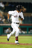 Scottsdale Scorpions shortstop Tzu-Wei Lin (7) runs to first during an Arizona Fall League game against the Salt River Rafters on October 14, 2015 at Scottsdale Stadium in Scottsdale, Arizona.  Scottsdale defeated Salt River 13-3.  (Mike Janes/Four Seam Images)