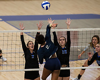 Trinity Luckett (5) of Bentonville West spikes through block of Lauryn Heinle (7) and Loryn Elkins (16) of Rogers at Rogers High School, Rogers, AR, on Thursday, September 9, 2021 / Special to NWADG David Beach