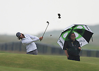 12th July 2021; The Royal St. George's Golf Club, Sandwich, Kent, England; The 149th Open Golf Championship, practice day; Tommy Fleetwood (ENG) hits an iron from the 18th fairway