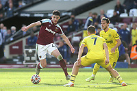 Declan Rice of West Ham takes on the Brentford defence during West Ham United vs Brentford, Premier League Football at The London Stadium on 3rd October 2021