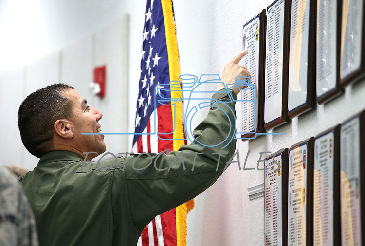 Nevada National Guard Col. Caesar Garduno checks out the newly unveiled tribute wall with the names of about 2,700 Nevada National Guard Soldiers and Airmen deployed into combat zones since Sept. 11, 2001, following a ceremony at the Office of the Adjutant General in Carson City, Nev., on Friday, April 17, 2015. <br /> Photo by Cathleen Allison
