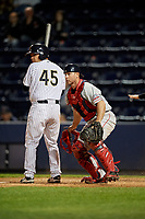 Pawtucket Red Sox catcher Dan Butler (12) checks the runner as Eddy Rodriguez (45) bats during a game against the Scranton/Wilkes-Barre RailRiders on May 15, 2017 at PNC Field in Moosic, Pennsylvania.  Scranton defeated Pawtucket 8-4.  (Mike Janes/Four Seam Images)