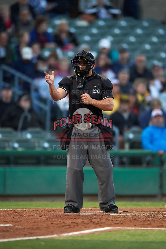 Home plate umpire Ricardo Estrada calls a strike during a California League game between the Rancho Cucamonga Quakes and the Stockton Ports at Banner Island Ballpark on May 16, 2018 in Stockton, California. Rancho Cucamonga defeated Stockton 6-3. (Zachary Lucy/Four Seam Images)