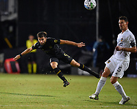 LAKE BUENA VISTA, FL - JULY 18: Diego Rossi #9 of LAFC passes the ball while Daniel Steres #5 of LA Galaxy looks on during a game between Los Angeles Galaxy and Los Angeles FC at ESPN Wide World of Sports on July 18, 2020 in Lake Buena Vista, Florida.