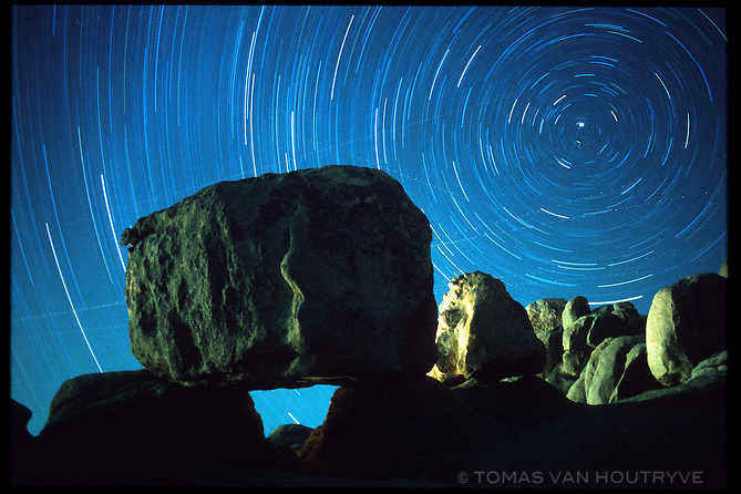 The movement of stars in the night sky is revealed during a 40 minute time exposure in Joshua Tree National Park in California in January 2001. (caused by the earth's rotation).<br />