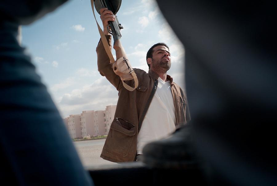 Man sings after funeral in Benghazi, Libya.