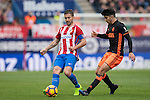 Carlos Soler of Valencia CF (right) competes for the ball during the match Atletico de Madrid vs Valencia CF, a La Liga match at the Estadio Vicente Calderon on 05 March 2017 in Madrid, Spain. Photo by Diego Gonzalez Souto / Power Sport Images