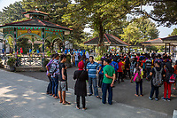Yogyakarta, Java, Indonesia.  Indonesians Visiting the Sultan's Palace Grounds.