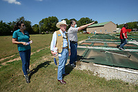 Al Drinkwater (center), a volunteer environmental quality consultant, helps answer questions Friday, Aug. 21, 2020, for Kim Patulak (from left), human resources director for the city of Springdale; Heath Ward, executive director of Springdale Water Utilities; and Chris Clark, financial analyst for Springdale Water Utilities, as the four inspect the former Bethel Heights wastewater treatment facility. The Benton County Election Commission certified that the results of an Aug. 11 election to annex Bethel Heights into Springdale. Visit nwaonline.com/200823Daily/ for today's photo gallery.<br /> (NWA Democrat-Gazette/Andy Shupe)