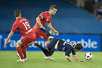 MELBOURNE, AUSTRALIA - OCTOBER 30: Robbie Kruse of the Victory is fouled during the round 12 A-League match between the Melbourne Victory and Adelaide United at Etihad Stadium on October 30, 2010 in Melbourne, Australia.  (Photo by Sydney Low / Asterisk Images)