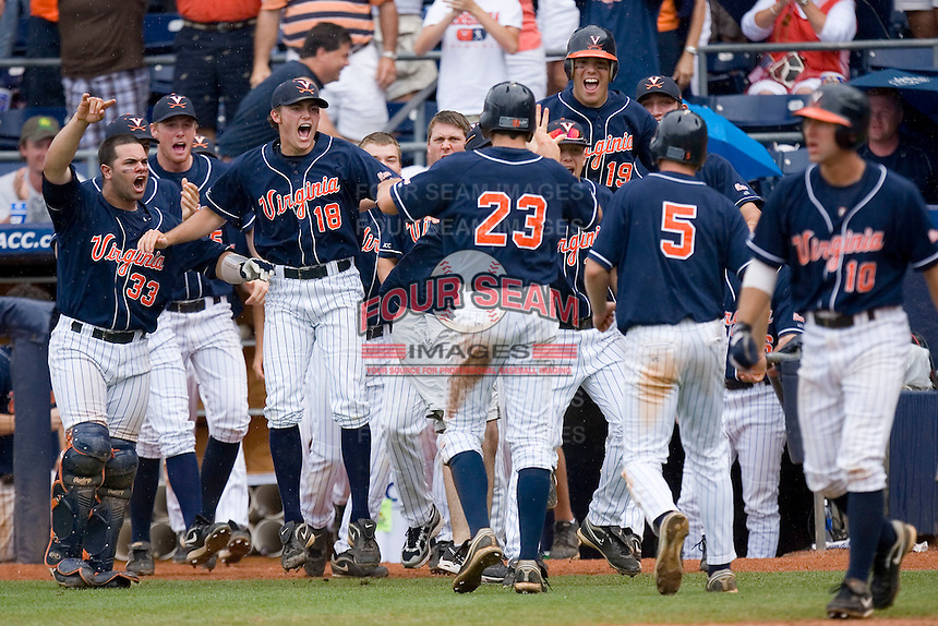 The Virginia Cavaliers bench erupts after 2 runs scored in the top of the 9th inning for a 5-3 lead over the Florida State Seminoles at Durham Bulls Athletic Park May 24, 2009 in Durham, North Carolina. The Virginia Cavaliers defeated the Florida State Seminoles 6-3 to win the 2009 ACC Baseball Championship.  (Photo by Brian Westerholt / Four Seam Images)