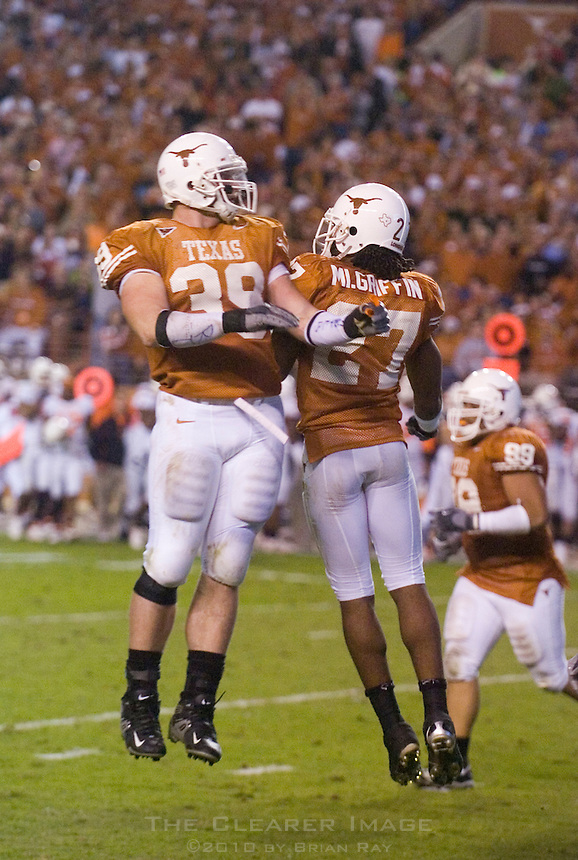 04 November 2006: Texas defenders Brian Robison (#39) and Michael Griffin (#27) celebrate after a play during the Longhorns 36-10 victory over the Oklahoma State University Cowboys at Darrel K Royal Memorial Stadium in Austin, Texas.