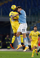 Hellas Verona s Adrien Fidele Tameze Aoutsa, left, and Lazio s Francesco Acerbi jump for the ball during the Serie A soccer match between Lazio and Hellas Verona at Rome's Olympic Stadium, December 12, 2020.<br /> UPDATE IMAGES PRESS/Riccardo De Luca