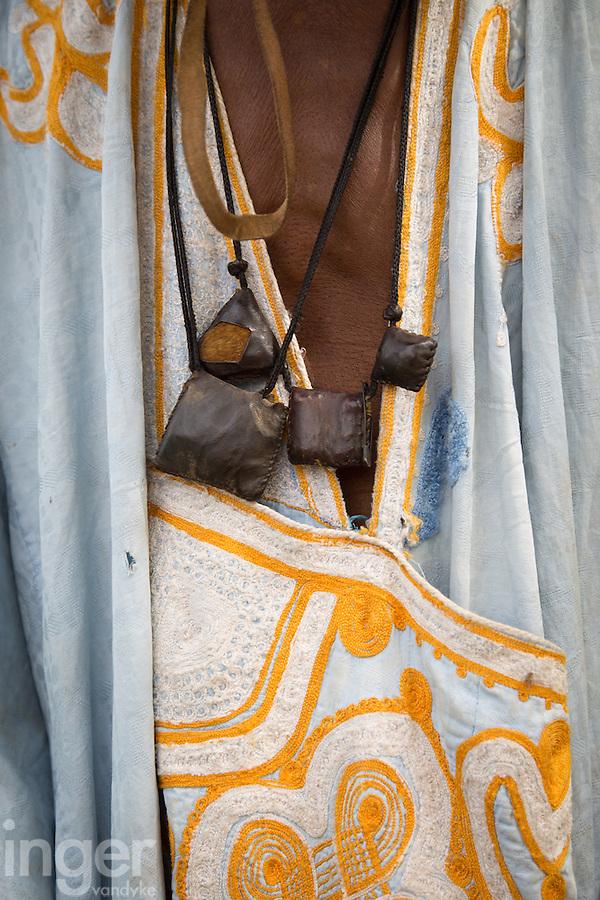 A Shepherd's good luck charms, Tambacounda, Senegal