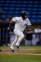 Staten Island Yankees Ezequiel Duran (25) runs to first base during a NY-Penn League game against the Aberdeen Ironbirds on August 22, 2019 at Richmond County Bank Ballpark in Staten Island, New York.  Aberdeen defeated Staten Island 4-1 in a rain shortened game.  (Mike Janes/Four Seam Images)