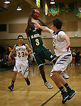 Manogue defenders James Sandoval, left, and Web Charles battle with Alumni Joe Tutson in the alumni game at the Wild West Shootout at Bishop Manogue High School in Reno, Nev., on Wednesday, Dec. 4, 2013. The Miners defeated the alumni 79-62. <br /> Photo by Cathleen Allison