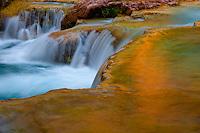 Samll water fall along Hauvasupi creek, in Havasupi Reservation, Arizona.