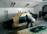 1996 File Photo<br /> <br /> An body shop employee spray paint a car using Dupont products.<br /> <br /> <br /> <br /> Mandatory Credit: Photo by Pierre Roussel- Images Distribution. (©) Copyright 1996 by Pierre Roussel <br /> <br /> NOTE : scan from 2 1/4 slide