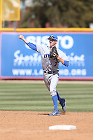 Clay Fisher (3) of the UC Santa Barbara Gouchos makes a throw during a game against the Cal State Northridge Matadors at Matador Field on April 10, 2015 in Northridge, California. UC Santa Barbara defeated Cal State Northridge, 7-4. (Larry Goren/Four Seam Images)