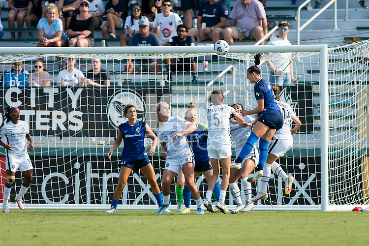 CARY, NC - SEPTEMBER 12: Kaleigh Kurtz #3 of the NC Courage wins a header over Emily Menges #5 and Lindsey Horan #10 of the Portland Thorns during a game between Portland Thorns FC and North Carolina Courage at WakeMed Soccer Park on September 12, 2021 in Cary, North Carolina.