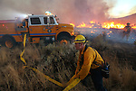 Firefighters battle a brush fire south of Clear Creek Road in Carson City, Nev. on Thursday, Oct. 13, 2016. <br /> Photo by Cathleen Allison