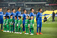 Carlos Tevez (far right) of Chinese football Super League team Shanghai Shenhua stands with team mates before the game with Beijing Guo'an at the Worker's stadium in Beijing. 2nd April, 2017.