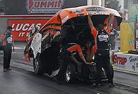 Apr. 5, 2013; Las Vegas, NV, USA: NHRA crew members for funny car driver Johnny Gray during qualifying for the Summitracing.com Nationals at the Strip at Las Vegas Motor Speedway. Mandatory Credit: Mark J. Rebilas-