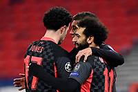 16th February 2021, Puskas Arena, Budapest, Hungary; Champions League football, FC Leipig versus Liverpool FC;  Liverpool's Mohamed Salah (r) celebrates with Liverpool teammates Curtis Jones (l) and Liverpool's Roberto Firmino (m) after scoring the 0:1 goal.