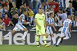 CD Leganes' Youssef En-Nesyri (l), Oscar Rodriguez Arnaiz (c-r) and Nabil El Zhar (r) celebrate goal in presence of FC Barcelona's Thomas Vermaelen dejected during La Liga match. September 26,2018. (ALTERPHOTOS/Acero)