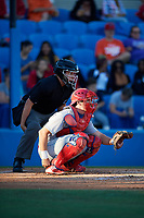 Umpire J.C. Velez and Clearwater Threshers catcher Austin Bossart (8) during a game against the Dunedin Blue Jays on April 8, 2017 at Florida Auto Exchange Stadium in Dunedin, Florida.  Dunedin defeated Clearwater 12-6.  (Mike Janes/Four Seam Images)