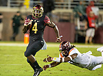 Virginia Tech defensive lineman Houshun Gaines (11) dives for Florida State running back Khalan Laborn (4)in the 2nd half of an NCAA college football game in Tallahassee, Fla., Monday, Sept. 3, 2018. Virginia Tech defeated Florida State 24-34.  (AP Photo/Mark Wallheiser)