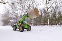 Farmer transporting hay to feed his livestock-  Rutland, February
