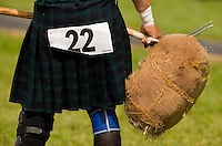 A competitor throws the sheaf in the heavy Scottish Athletic Events during the 52nd Annual Grandfather Mountain Highland Games in Linville, NC.