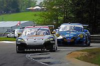 #42 Team Sahlen Mazda RX-8 of Dane Cameron & Wayne Nonnamaker, #67 TRG Porsche GT3 of Steven Bertheau & Spencer Pumpelly class: Grand Touring (GT)